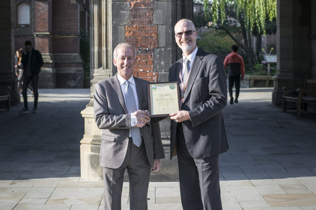 Terry Croft Presenting Newcastle University Registrar Dr John Hogan with PA certificate